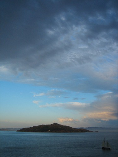 Angel Island at dusk with boat