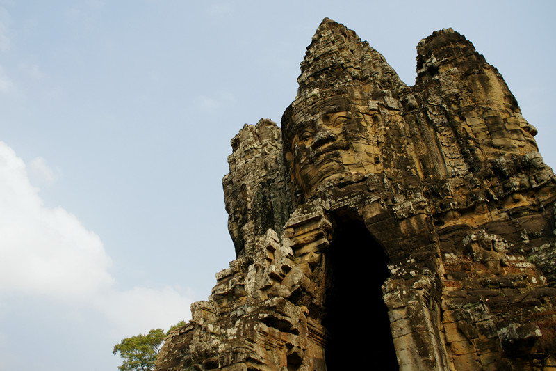 Smiling faces look out from the south gate of Angkor Thom