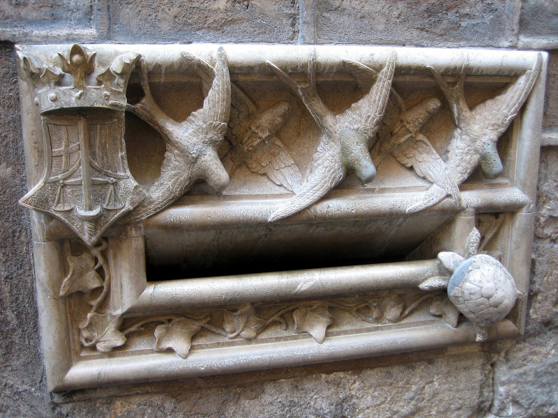 Lucky turtle and swallow mail slot at the Casa de l'Ardiaca (Archdeacon's House) in Barcelona, Spain (copyright Kathryn Watt)