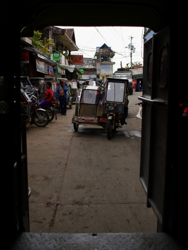 A trike seen through the back of our jeepney in Banaue, Philippines