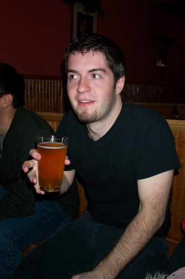 Justin, newly 24, with a beer