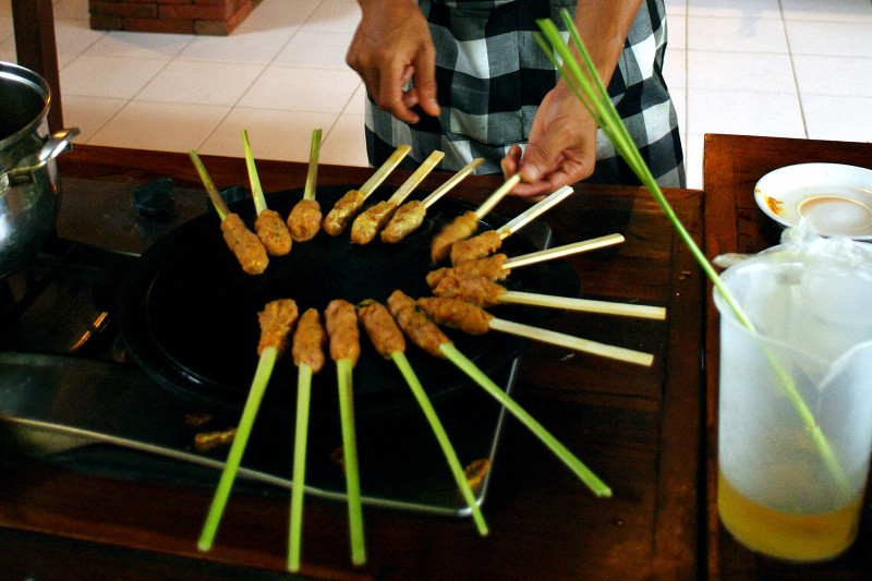 bumi bali cooking class grilling sate lilit