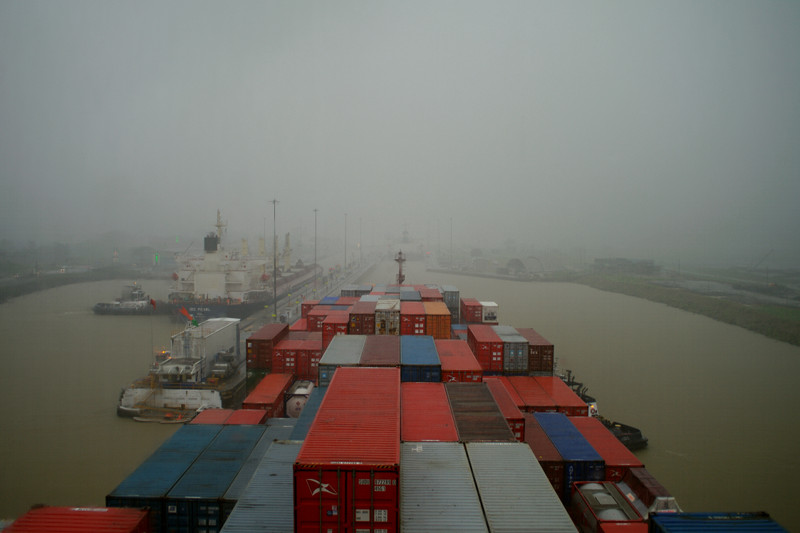 Approaching the Pedro Miguel Locks of the Panama Canal in the rain