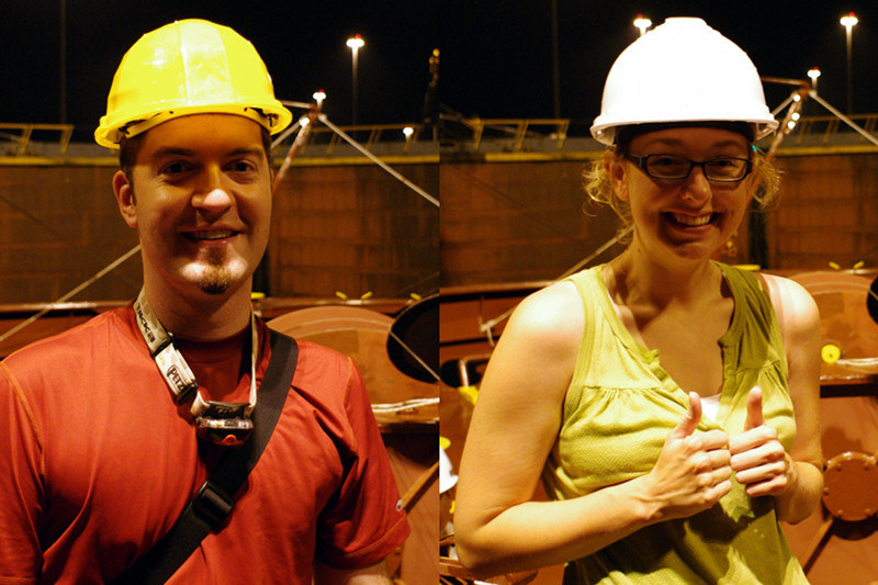 Justin and Stephanie in hardhats at the forecastle of the Cap Cleveland, approaching the Gatun Locks of the Panama Canal