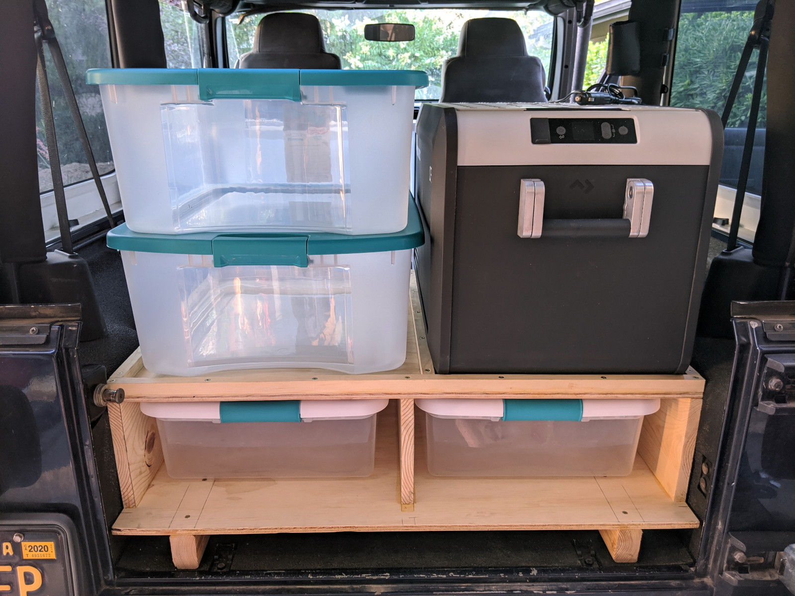 Cabinet with plastic bin drawers, cooler, and additional plastic bin storage