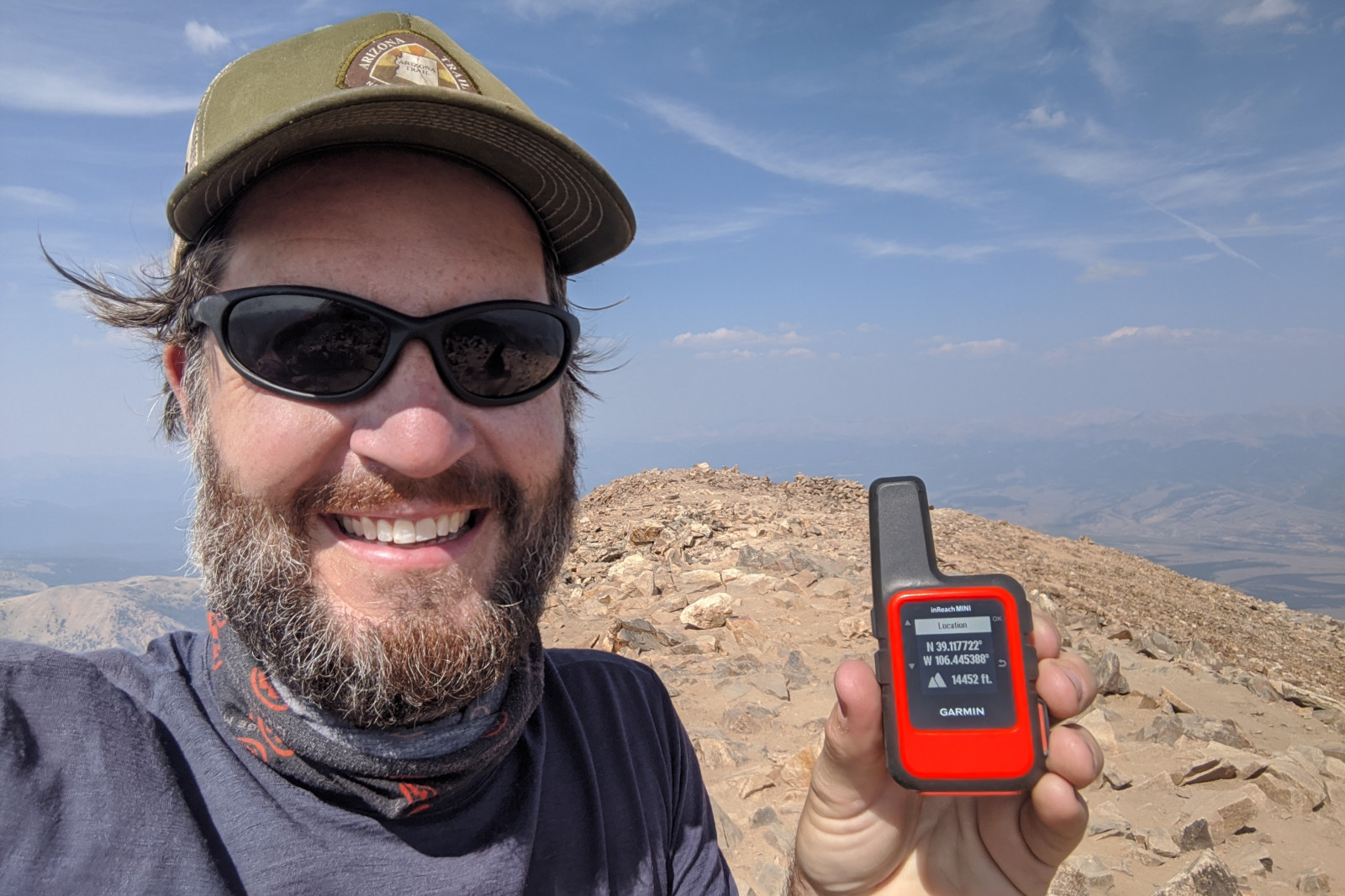 Justin at the summit of Mount Elbert with an inReach