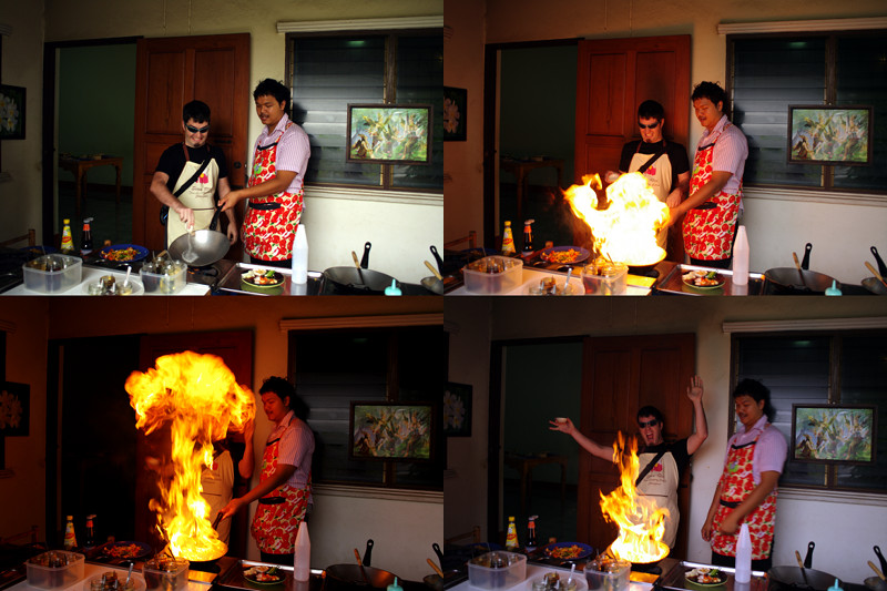Justin making a big ball of fire in the kitchen of the Siam Rice Thai Cookery School in Chiang Mai, Thailand