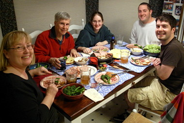 The whole family enjoying a Christmas Eve Raclette