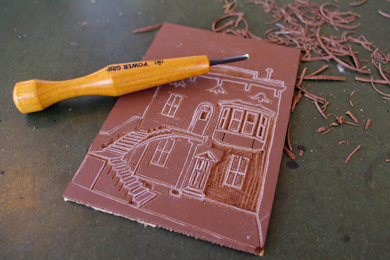 Carving linoleum for a linocut print