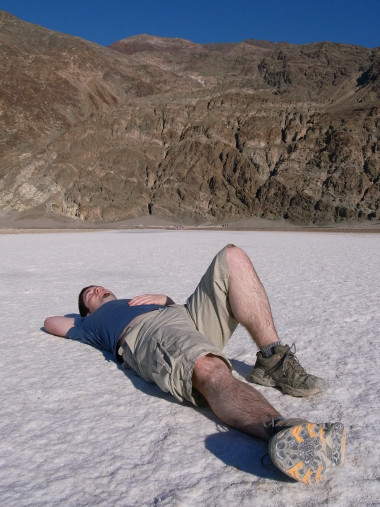 Justin laying down on the Badwater Basin
