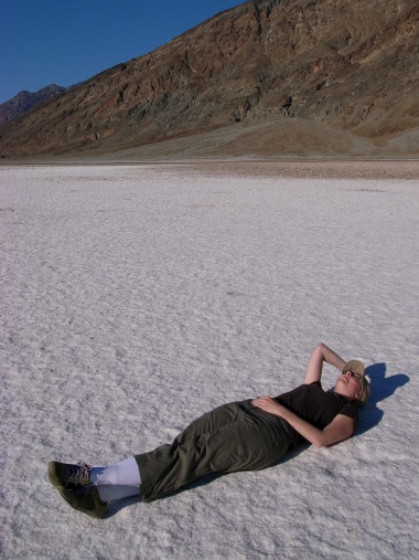 Stephanie laying down on Badwater Basin