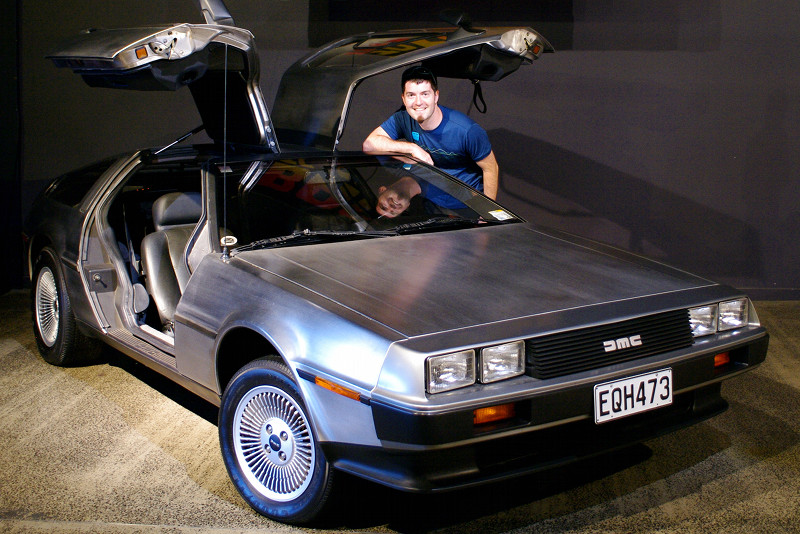 Justin posing with a 1981 DeLorean DMC-12 at the WOW Classic Cars Museum in Nelson, New Zealand