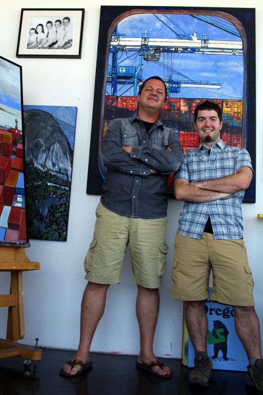"Eric Rewitzer and Justin Watt standing in front of Eric's ""Portal"" painting"