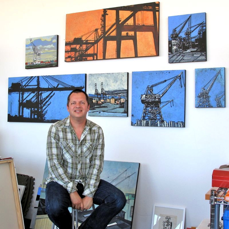 Eric Rewitzer with his Port Authority container crane paintings