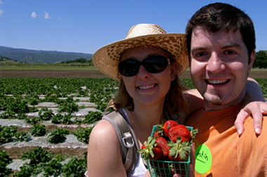 Stephanie and Justin showing off their strawberries