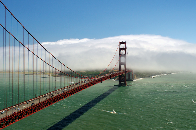 The Golden Gate Bridge disappears into the fog