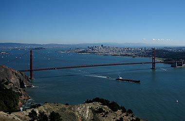 Golden Gate Bridge with container ship