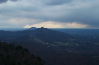pilot mountain (in the distance) surrounded by clouds pregnant with the season's first snow