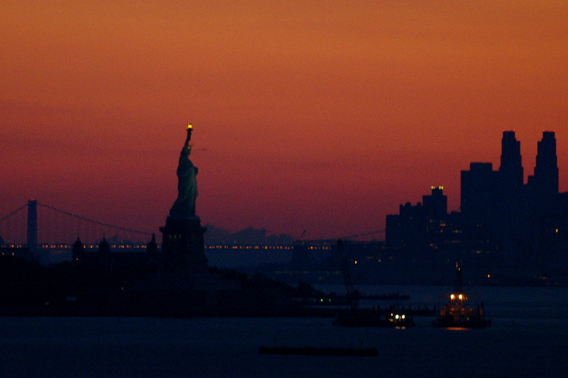 Silhouetted Statue of Liberty, seen from the Hanjin Palermo