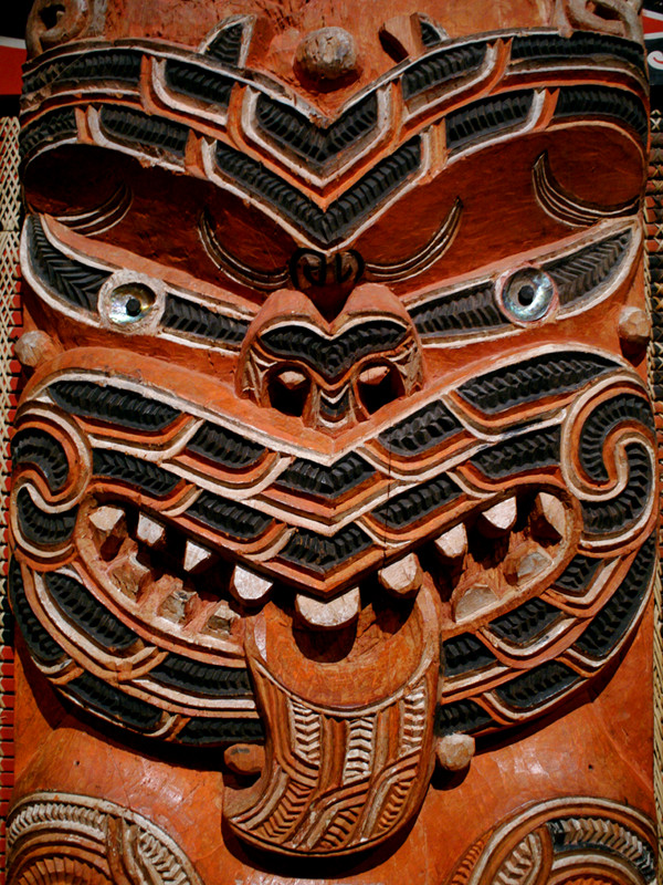 Carved face on one of the spines of the Hotunui wharenui