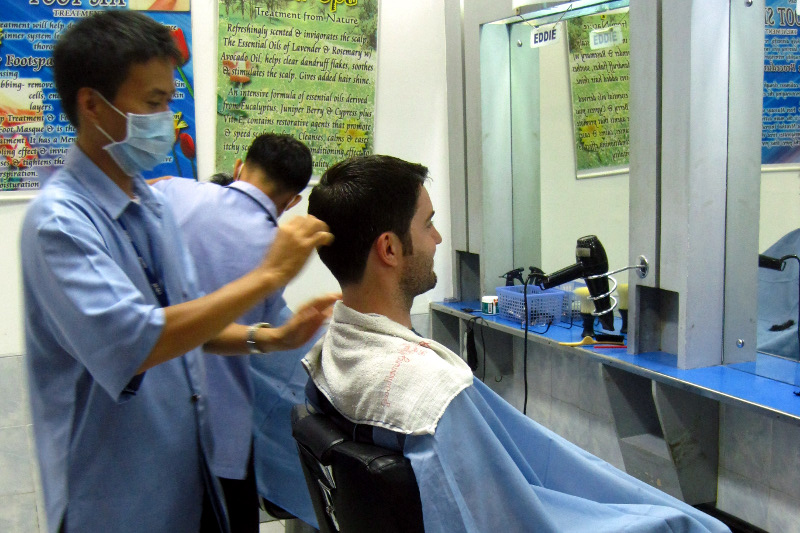 Justin getting a haircut at the barber in SM City, Iloilo