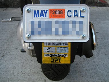 Inspection sticker plate installed, with San Francisco parking permit