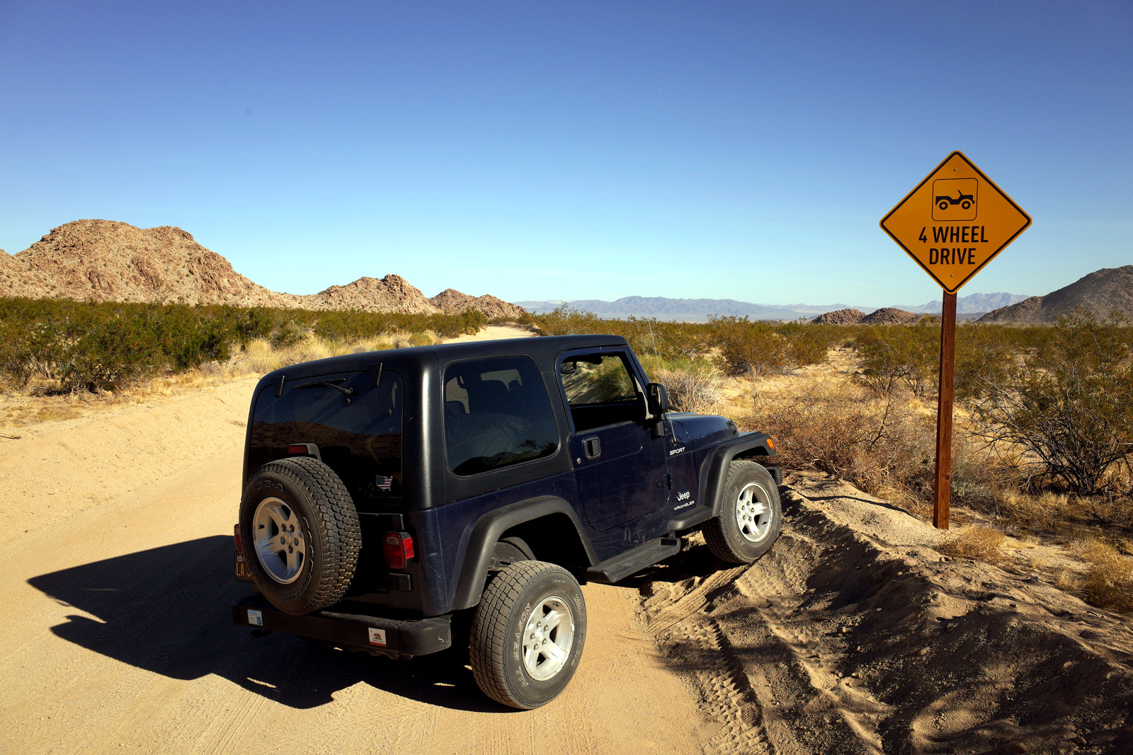 La Jeep posing with the 4 Wheel Drive sign on Old Dale Road in Joshua Tree National Park