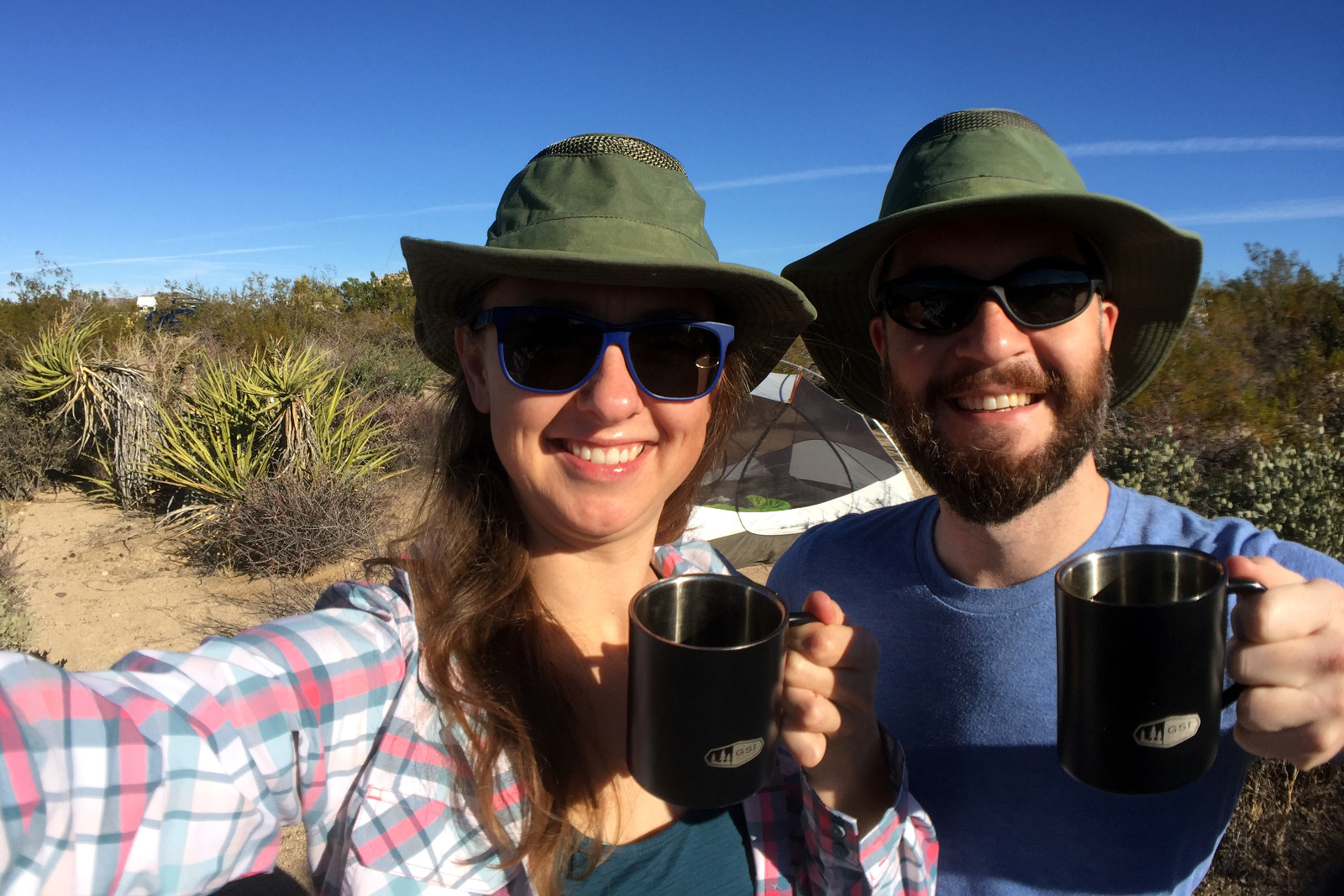 Justin and Stephanie with coffee mugs at Cottonwood Campground in Joshua Tree National Park