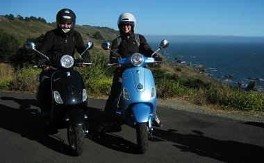 Justin and Stephanie on Vespas overlooking the Pacific on CA-1