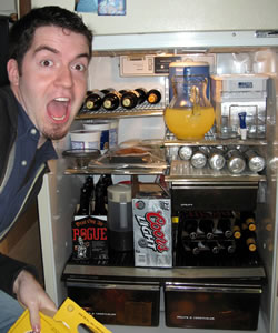 Justin posing with fridge full of beer for the super bowl