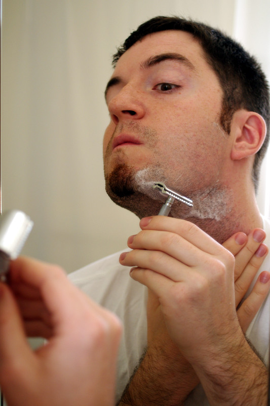 Justin shaving jaw with safety razor