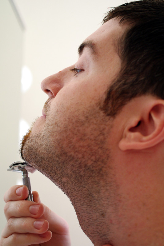 Justin shaving neck with safety razor