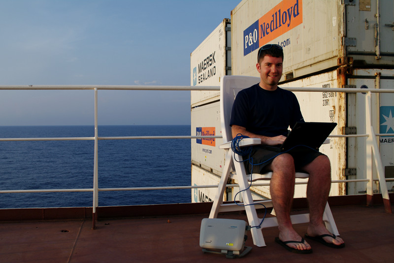 Justin using a Sabre 1 BGAN Terminal to access the internet on the Cap Cleveland, somewhere between Jamaica and Colombia