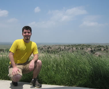justin posing in front of the high plains of the texas panhandle