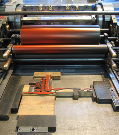Getting ready to print the cover on a Vandercook 4