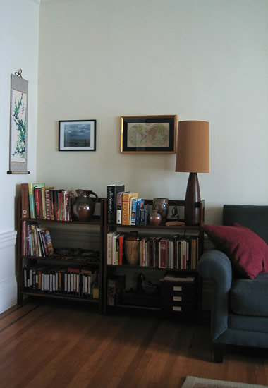 living room corner with pictures on the wall