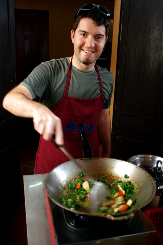 Justin stir-frying at the Tamnak Lao cooking class in Luang Prabang, Laos