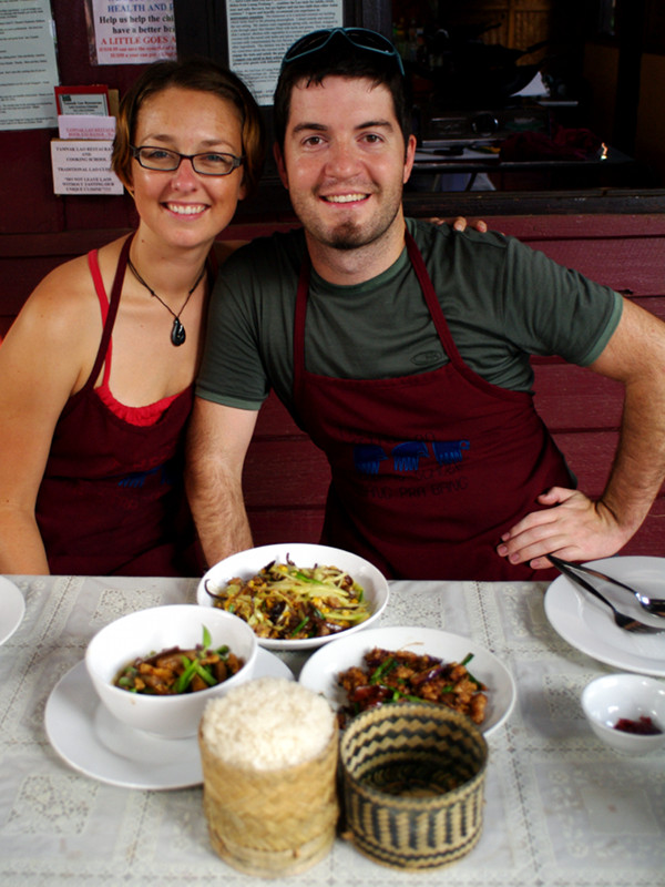 Stephanie and Justin sitting down to dinner at the Tamnak Lao cooking class in Luang Prabang, Laos