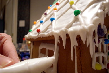 Stephanie making gingerbread house icicles