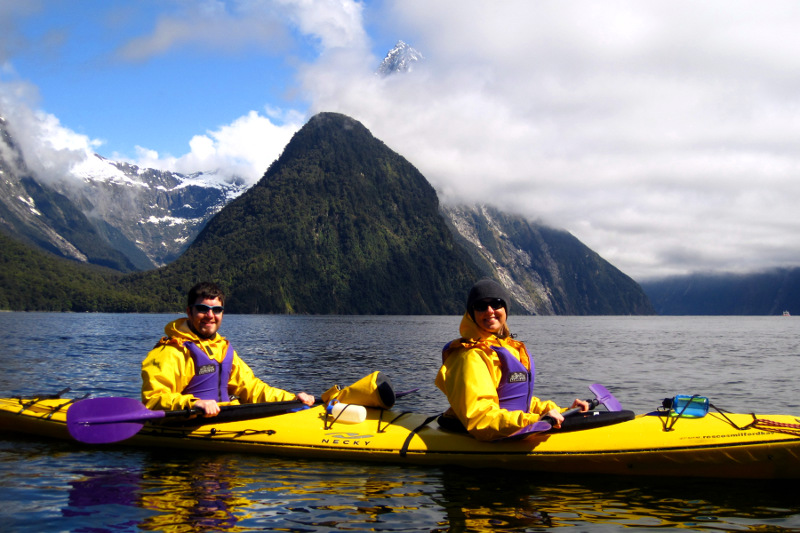Justin and Stephanie in a tandem kayak in Milford Sound (Mitre Peak is in the clouds behind us)