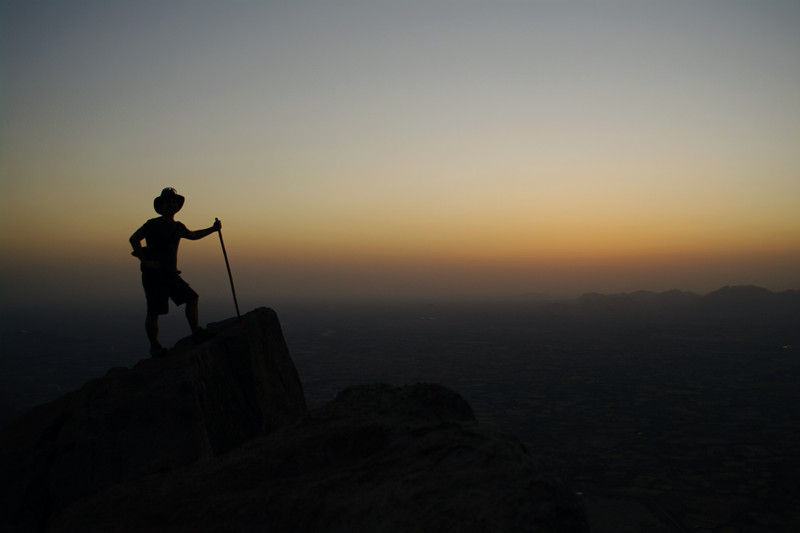 Silhouette of Justin at sunset in Mount Abu, India