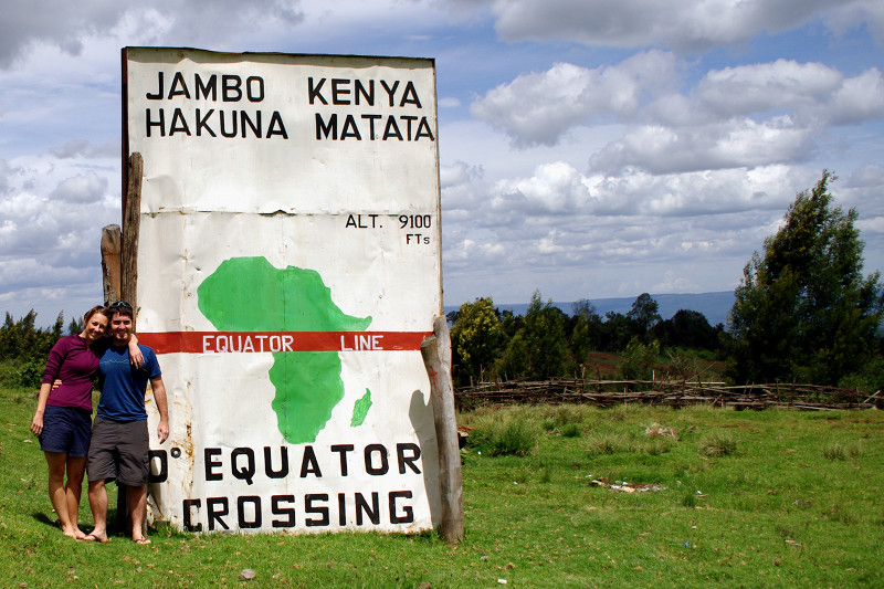 Stephanie and Justin standing on the equator in Kenya
