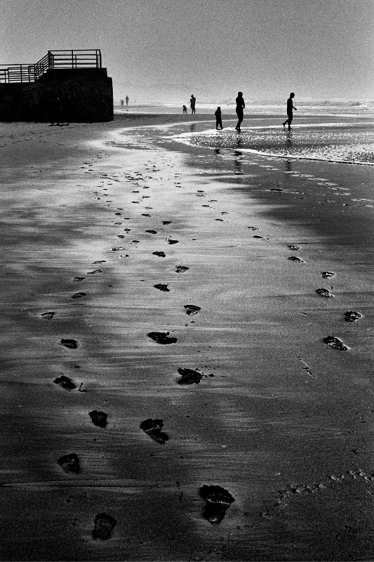 Footprints in the sand at Ocean Beach, San Francisco, CA