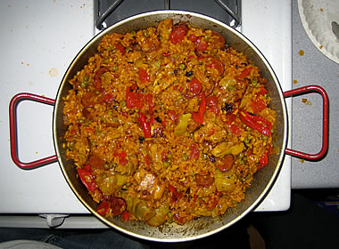 Paella cooking in a paella pan
