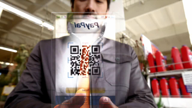 Screenshot from PayPal's Future of Shopping video using a QR Code that points to justinsomnia.org