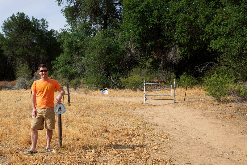 Justin posing with southbound trail marker where the PCT crosses California County Route S22