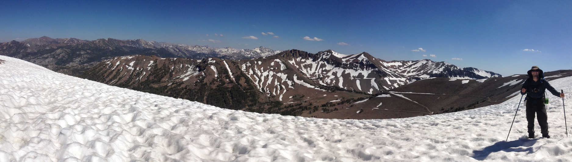 Panorama of Justin on snowfield at mile 1010 of the Pacific Crest Trail