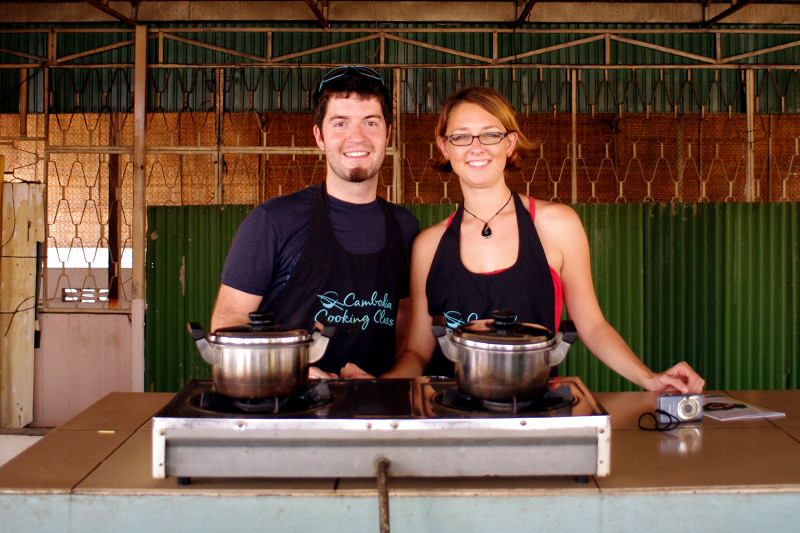 Justin and Stephanie behind the stove at Cambodia Cooking Class in Phnom Penh