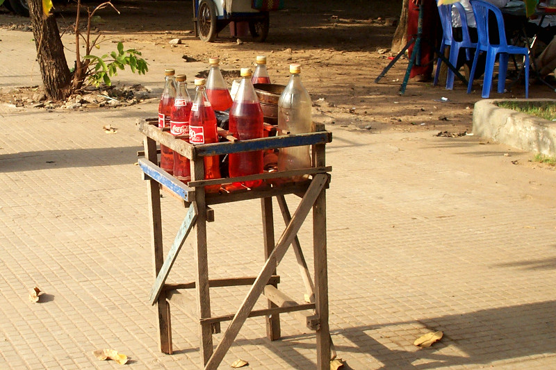 Petrol in coke bottles by the side of the road (for motos)