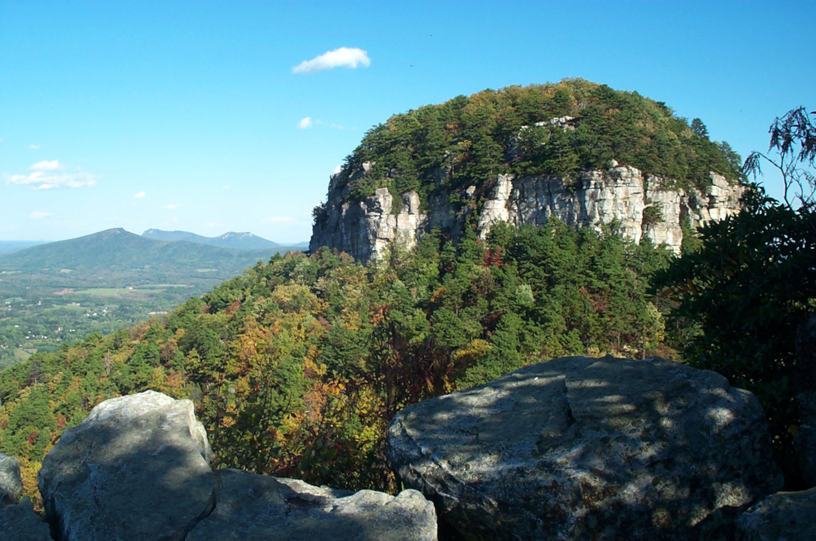 pilot mountain with unknown mountains in the distance